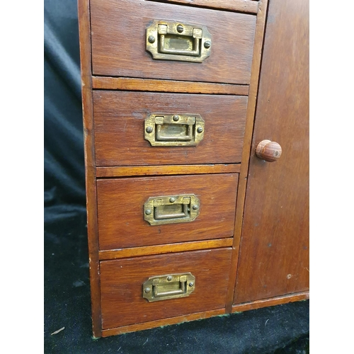 1224 - A wooden six drawer cabinet with miniature military handles....