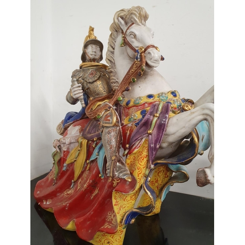 1234 - A pair of large model porcelain horses with knights....