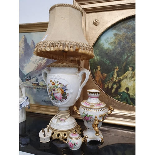 1239 - A french style porcelain lamp with shade together with a porcelain urn and miniature teapot....