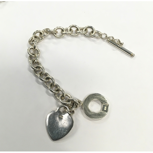 1324 - Silver heart necklace and matching bracelet....