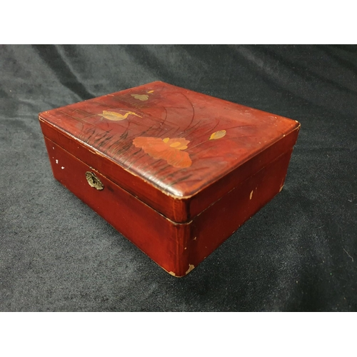 1264 - A small oriental box containing costume jewellery....