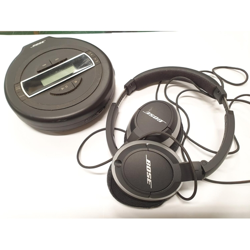 1280 - A Bose PM-1 CD Walkman together with a pair of Bose headphones....