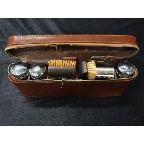 1288 - A gentleman's vintage brush set in leather case....