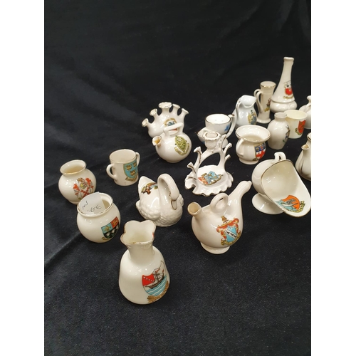 1306 - A collection of assorted crested china to include Goss....