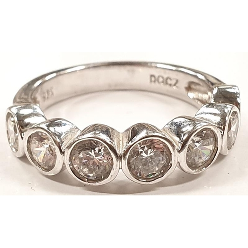 1311 - A ladies silver 7 stone ring size O....