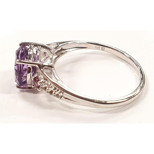 1312 - A ladies silver and amethyst ring size N....