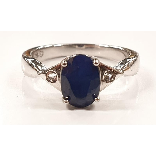 1314 - A ladies silver and sapphire ring size L....