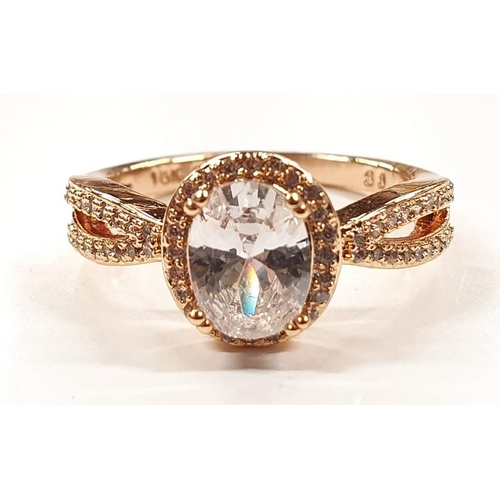 1319 - A ladies gold coloured fashion ring with white stone size P....