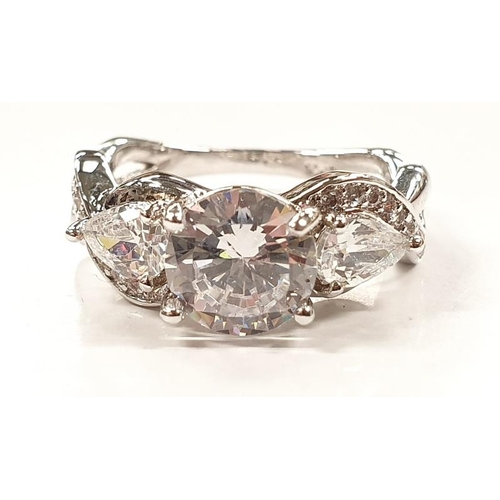 1320 - A ladies fashion ring with three white stones size P....