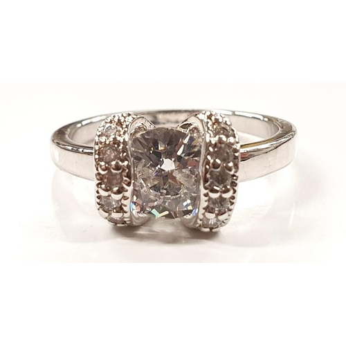 1321 - A ladies fashion ring with white stone size O....