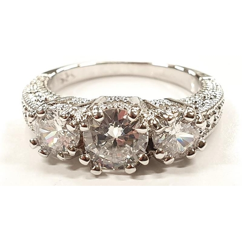 1322 - A ladies fashion ring with three large white stones size P....