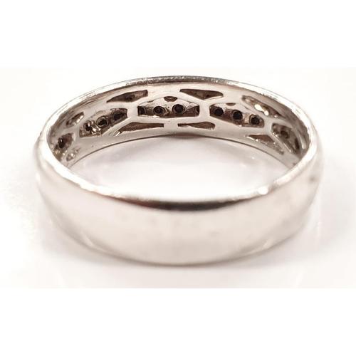 1331 - A black diamond half eternity 9ct white gold ring size K+....