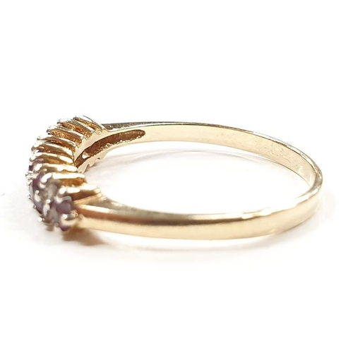1332 - A diamond and amethyst 9ct gold ring size P....