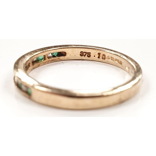 1333 - A diamond and emerald half eternity 9ct gold ring size O....