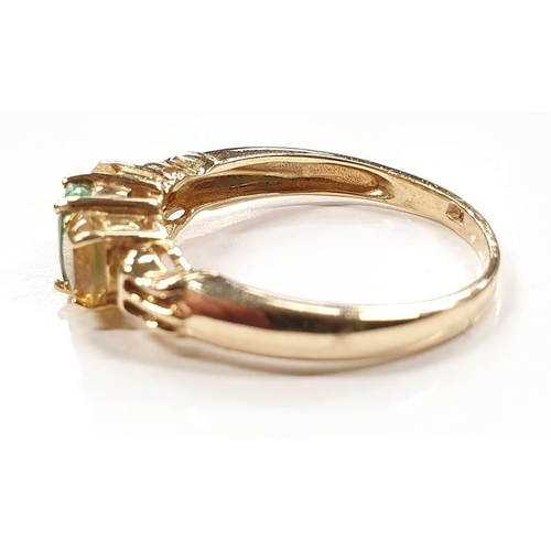 1334 - A three stone 9ct gold ring size O....