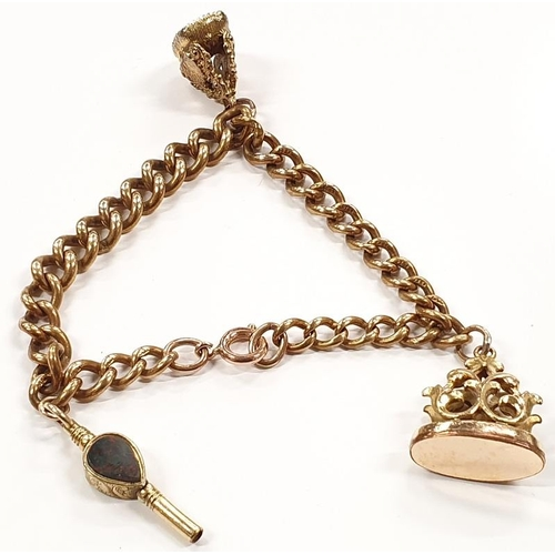 1335 - A Victorian/Edwardian seals and watch key on gold coloured bracelet....