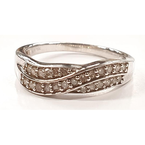 1337 - A diamond and silver ring size O....