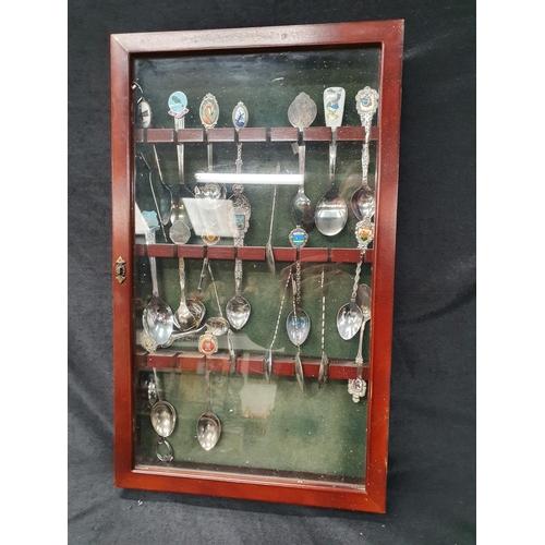 1369 - A collection of souvenir teaspoons in a case....