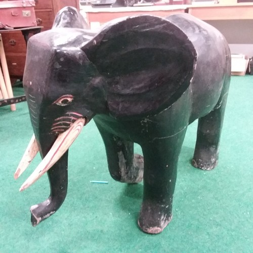1383 - A large wooden carved elephant statue....