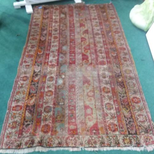 1381 - An Afghan faded rug.170 x 80 cm....