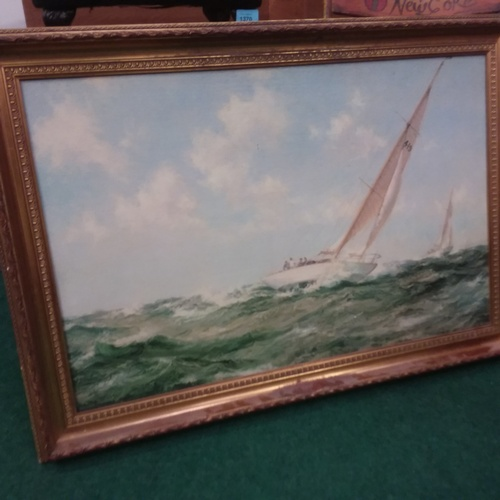 1384 - A gilt framed oil on canvas two yachts racing....