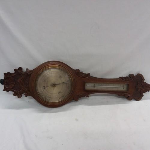 1408 - An antique oak banjo barometer (af) together with two walking sticks....