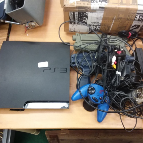 1401 - A PlayStation 3 games console together with various controllers and cabling....
