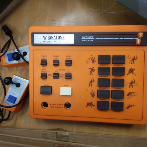1403 - A Binatone vintage games console with controllers....