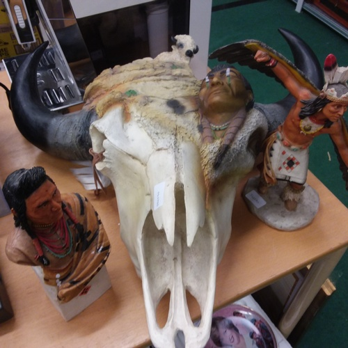 1410 - A modern decorative Indian themed animal skull together with two Indian figures....