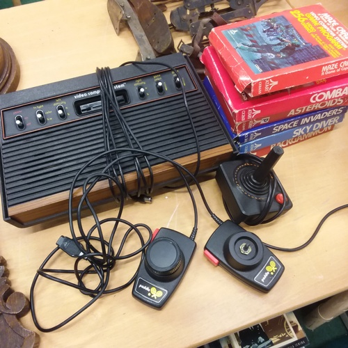 1415 - A vintage Atari 2600 Video Computer System gaming console together with one joystick, set of paddle ...