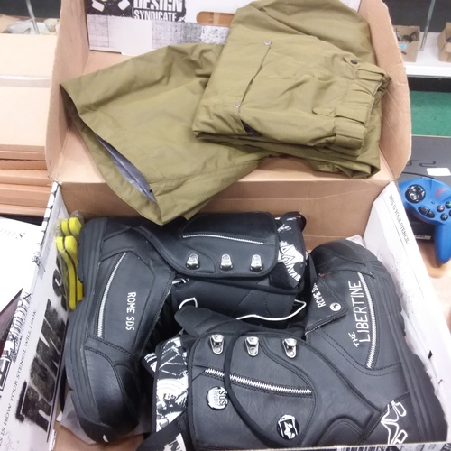 1421 - A pair of boxed Libertine snowboard boots together with a pair of Oakley snow board trousers....