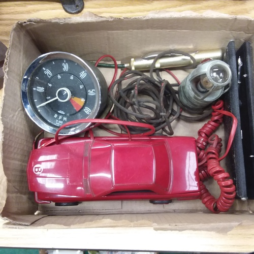 1428 - A box of automobilia to include a car phone and a rev counter....