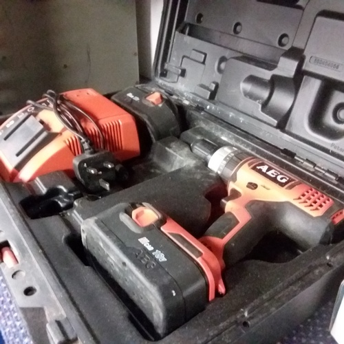 2022 - An AEG NiCad drill with two batteries, a charger and case....