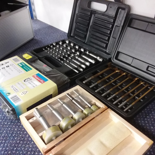 2026 - A collection of assorted drill bit sets and a magnetic tool strip....