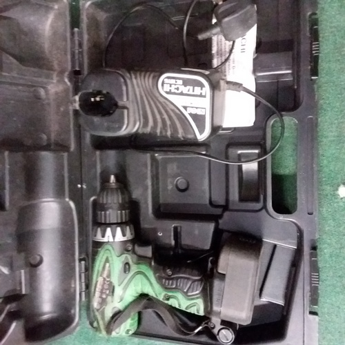 2047 - An Hitachi drill with battery, charger and case....