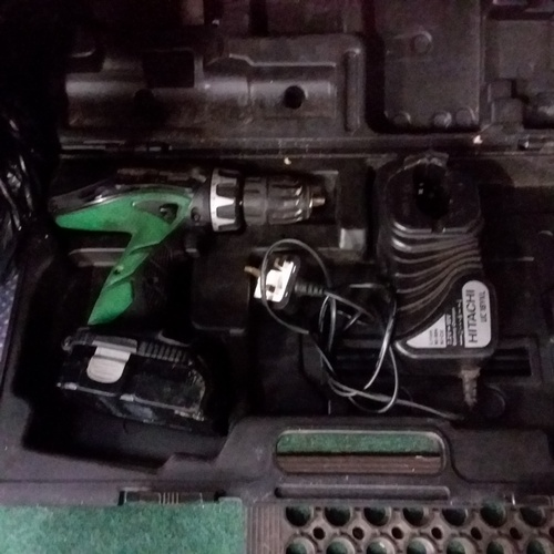 2051 - An Hitachi drill with battery, charger and case....