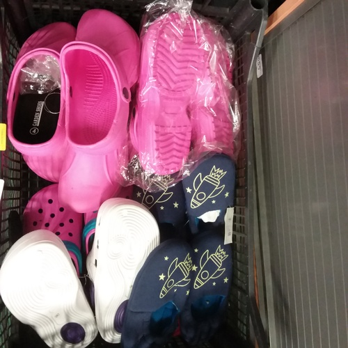 2052 - A crate with assorted garden shoes, mostly pink....