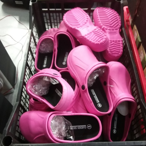 2056 - A crate with pink garden shoes....