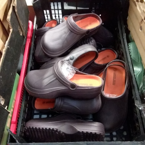 2058 - A crate of brown garden shoes....