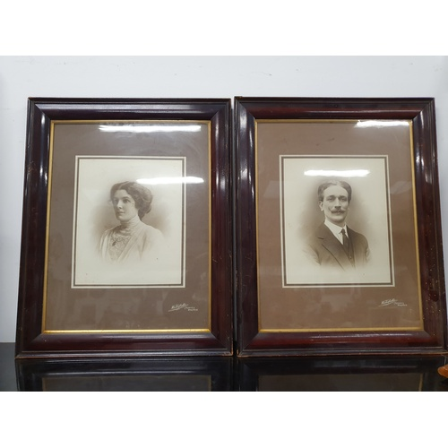 1242 - A pair of framed and glazed Victorian photographs of a lady and a gentleman....