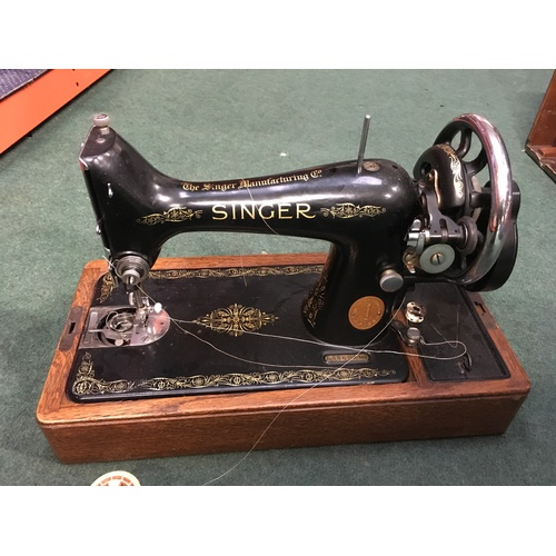2046 - A Singer sewing machine with carry case....