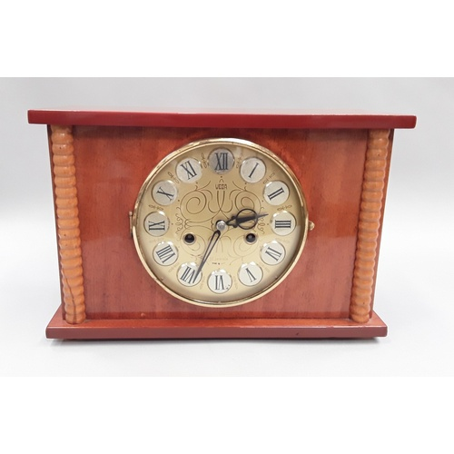393 - Period 8-day chiming 12 jewel mantle clock with key....