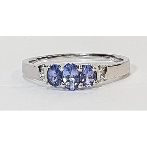 456 - 9ct white gold ladies tanzanite and diamond ring, size N....