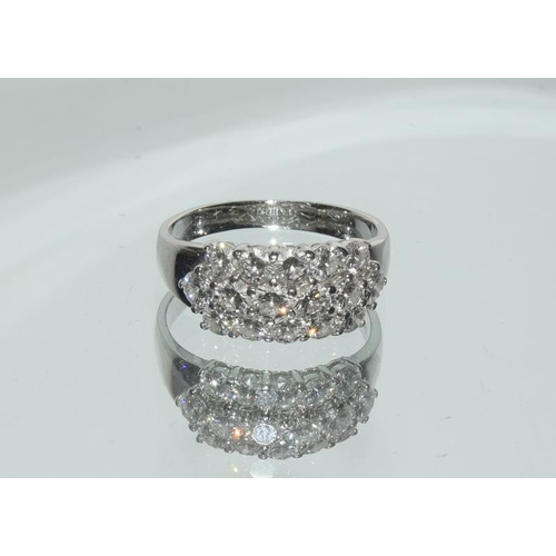 458 - 18ct white gold Diamond ring, set with 18 brilliant cut stones - 1.5cts approx. Size P....
