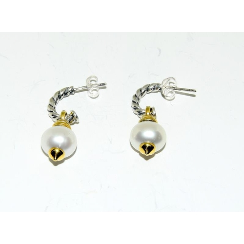 427 - Pair of silver and pearl earrings....