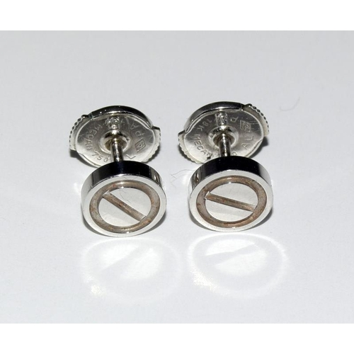 524 - A pair of Cartier genuine 18ct white gold earring studs....