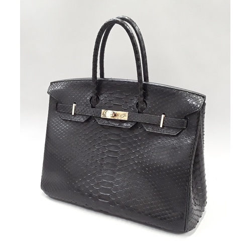 46 - Hermes vintage black handbag - measuring 35cm from seam to seam across the base, and 26cm high at th...