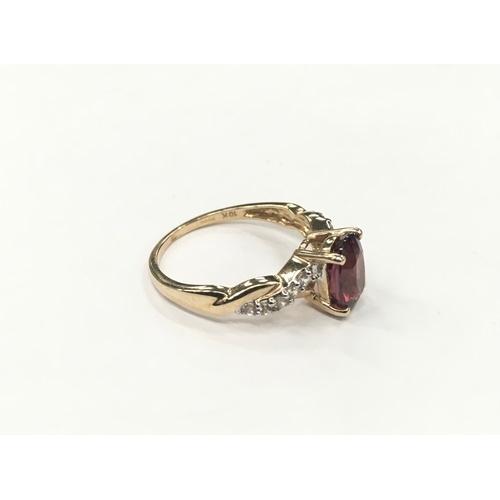 395 - 10ct gold diamond and garnet ladies ring. Size N....