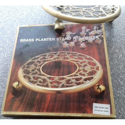 1123 - Brass planter stand with wheels, plant pots, gardening books, set of 3 new ceramic wall vases....