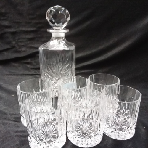 1038 - A whisky decanter with six matching glasses....